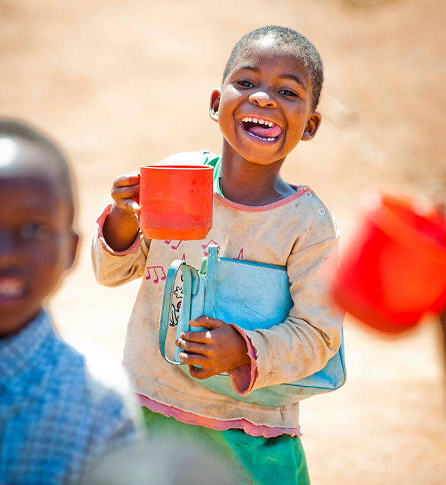 A young girl eating porridge Pic: Chris Watt