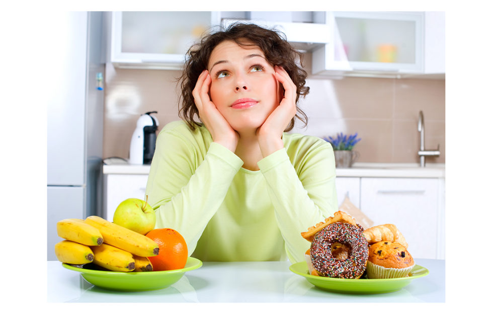Lady looking at two bowls of food Pic: Shutterstock
