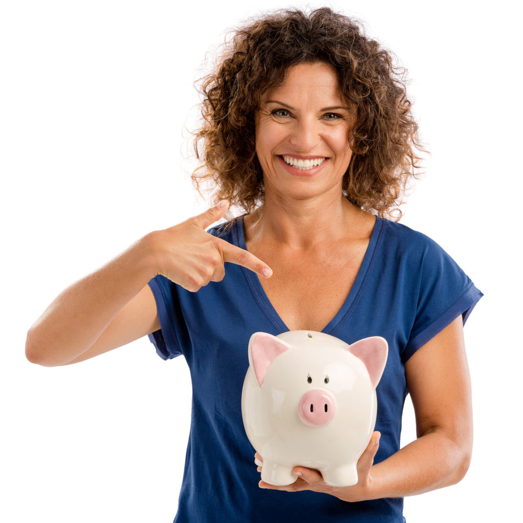 Woman pointing to piggy bank