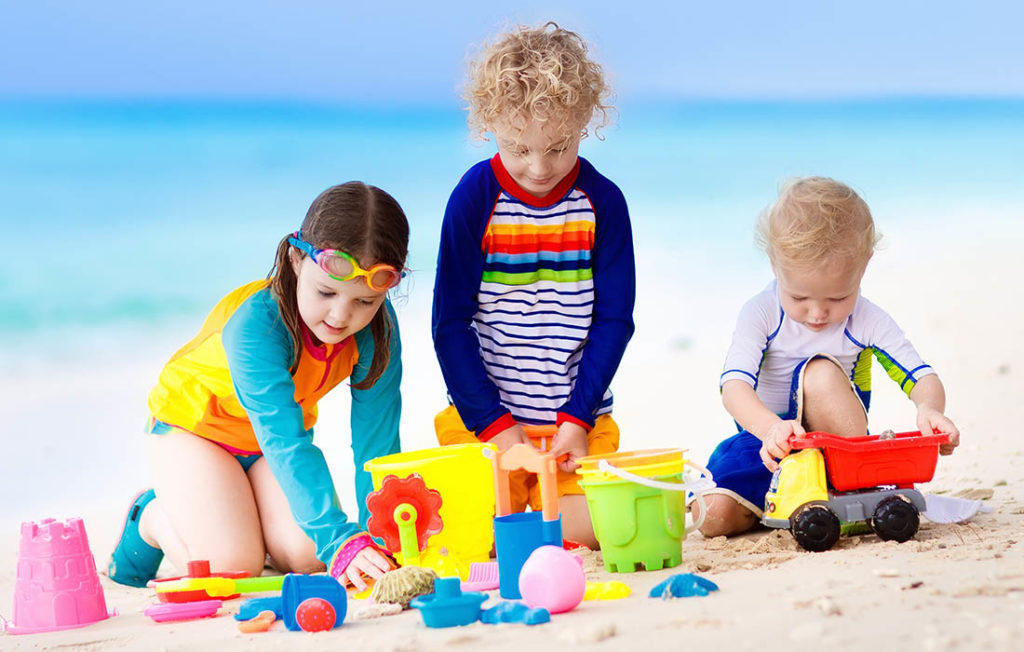 Kids playing with toys at beach abroad Pic: Shutterstock