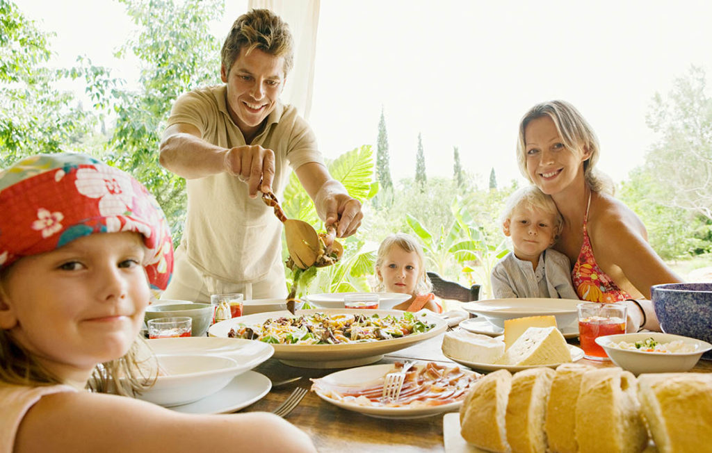 A family eating al fresco at the villa Pic: Shutterstock