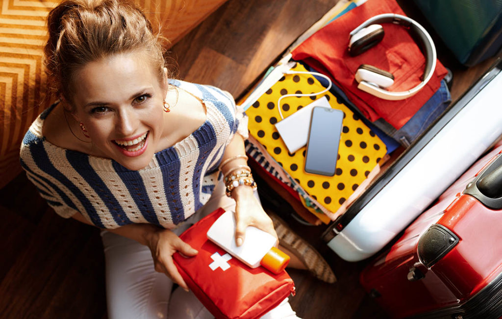 Lady packing medicine into suitcase Pic: Shutterstock