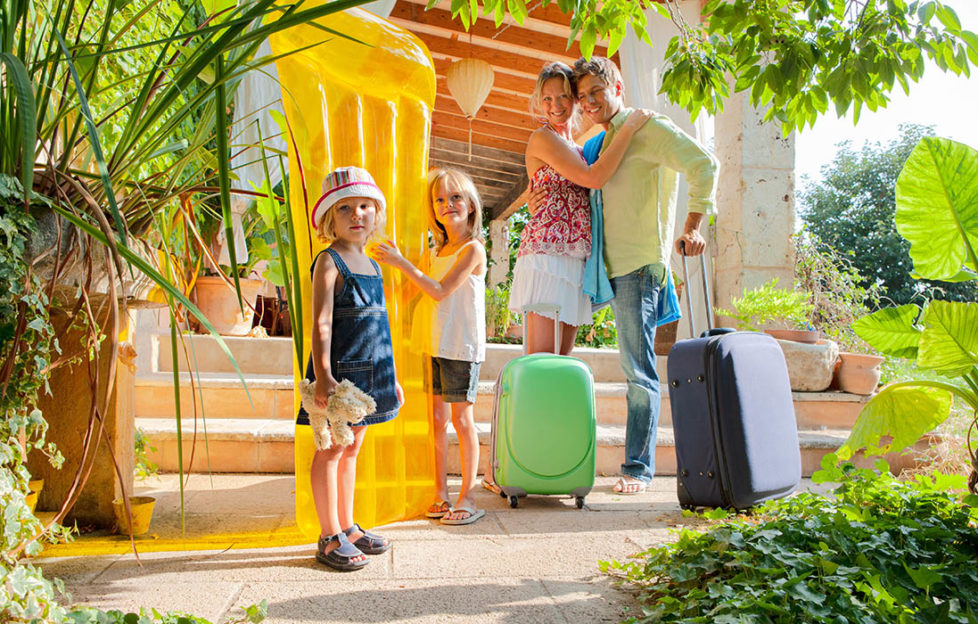 Young family abroad at villa Pic: Shutterstock