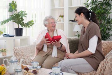 Daughter giving mum a gift on Mother's Day Pic: Shutterstock