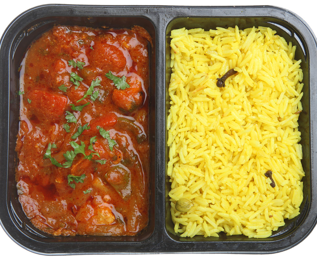 Indian chicken curry with rice in supermarket packaging tray.;