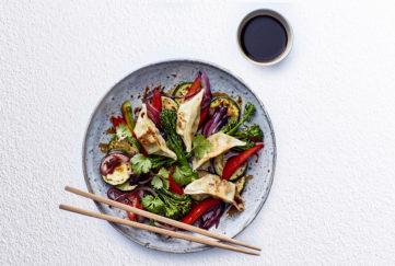 gyoza stir fry with chopsticks