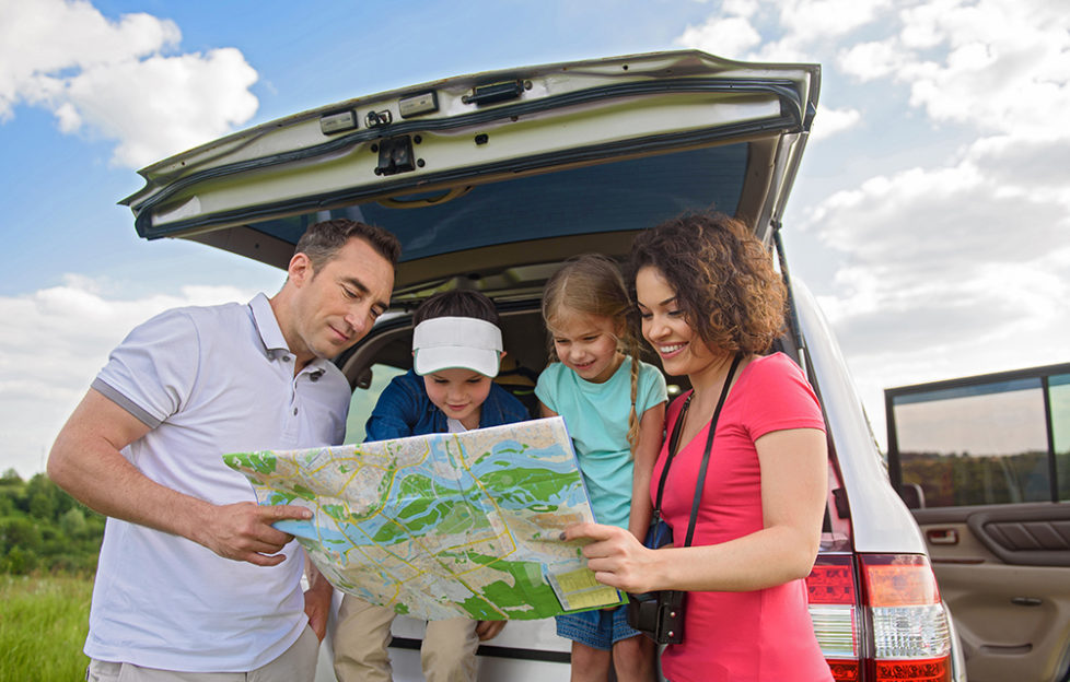 Happy family enjoying road trip and summer vacation; Shutterstock ID 471296090