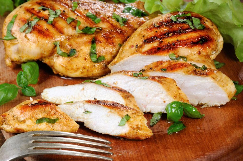Sliced juicy, tender chicken breast grill close-up.;
