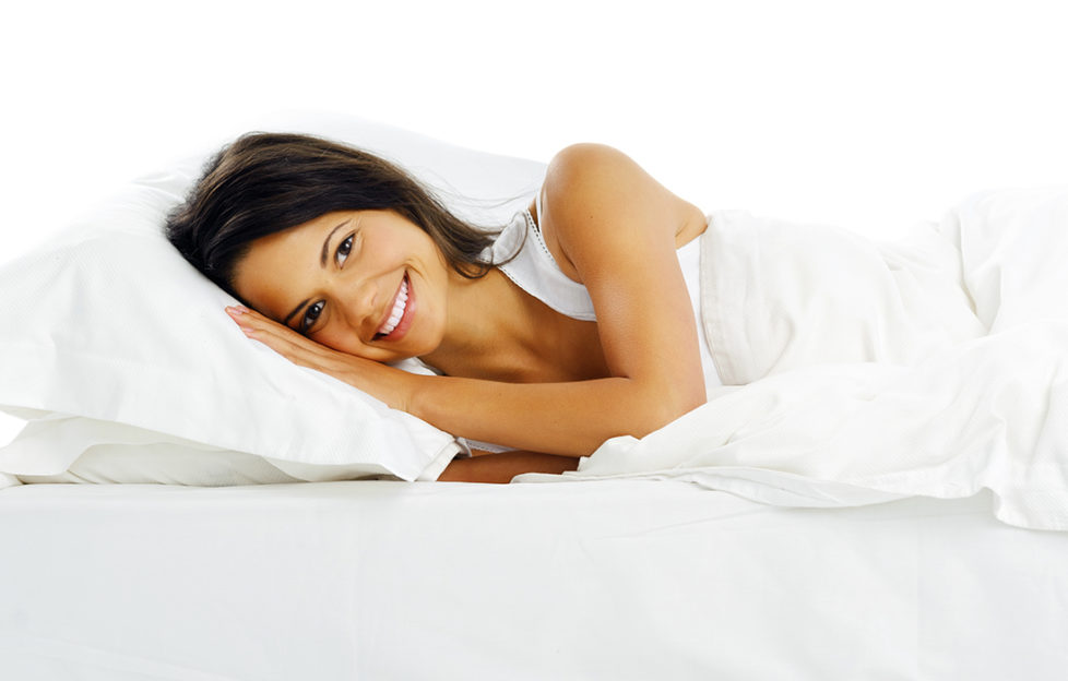Lady comfortable in bed Pic: Shutterstock