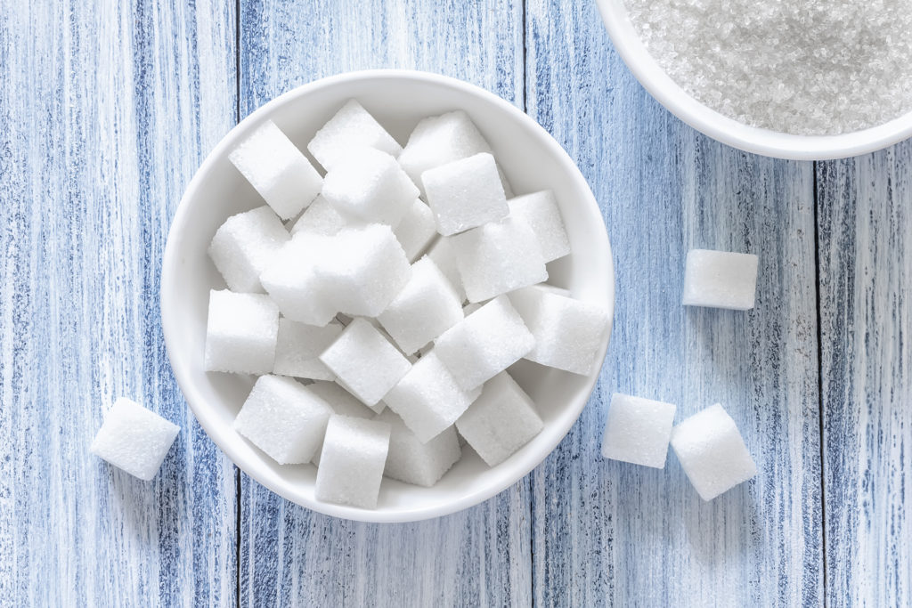 Cubes of sugar in a white dish