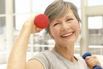 Senior exercising at gym;