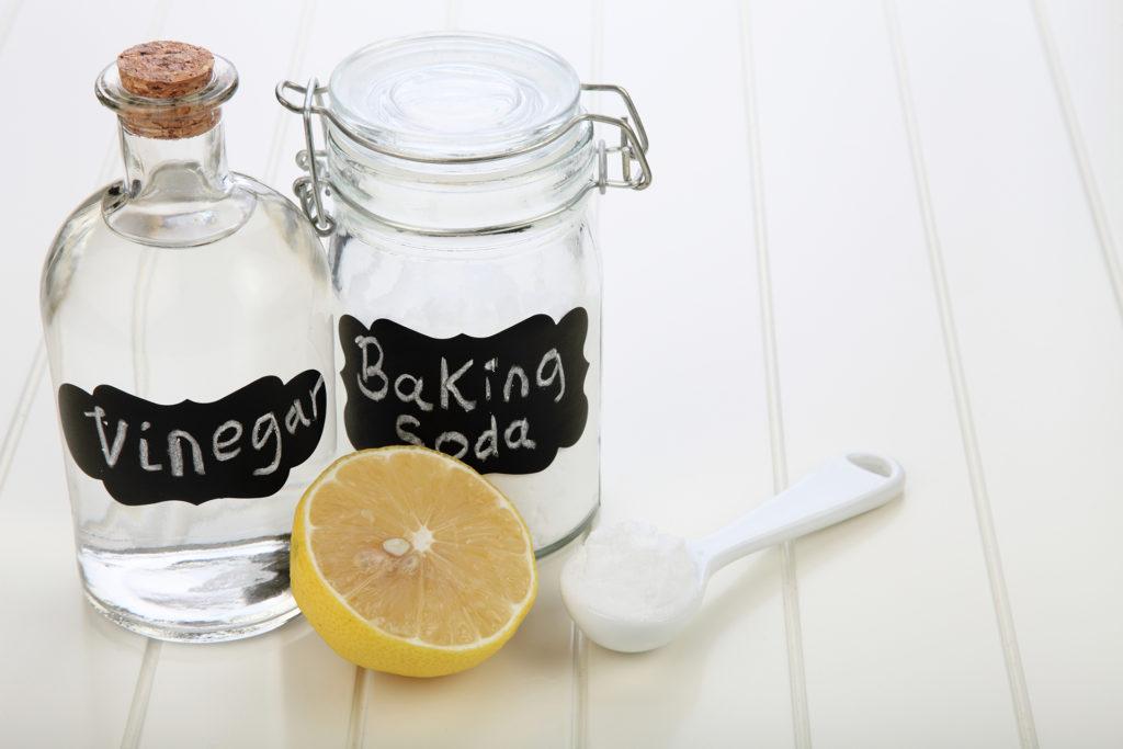 baking soda vinegar and lemon on the white background;