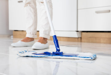 Cleaning Service Woman Mopping The Floor In Kitchen At Home;
