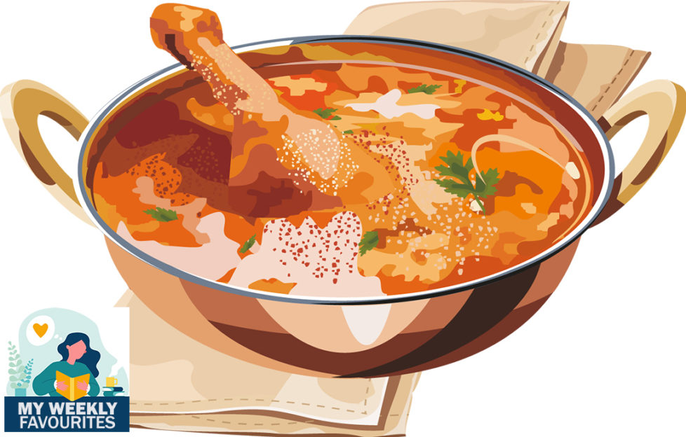 Cooking dilemma. Richly coloured dish of curry, chicken drumstick sticking out