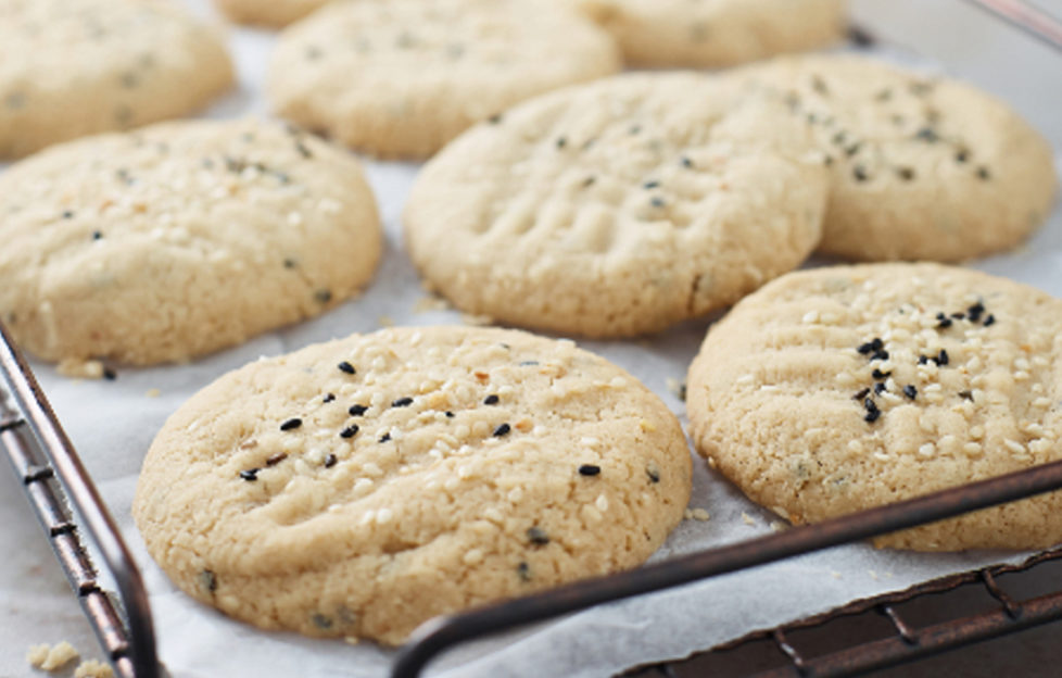 pale golden tahini cookies on cooking rack