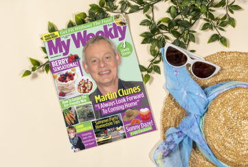 My Weekly latest issue with Martin Clunes and summer berry cookery. Styled shot with straw hat, blue scarf, sunglasses and ivy branches