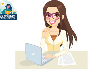Woman smiling sitting at computer, looking thoughtful