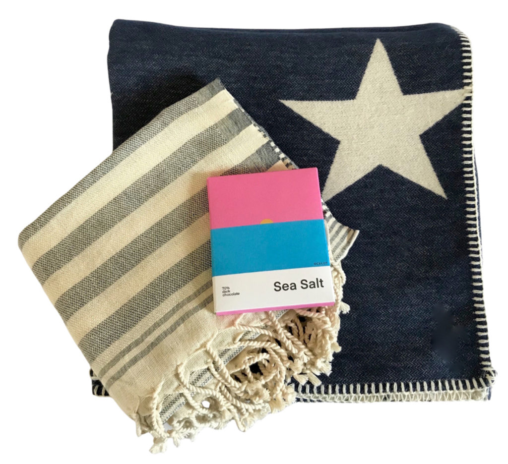 Gift set of blanket with star, towel and chocolate bar, eco gift