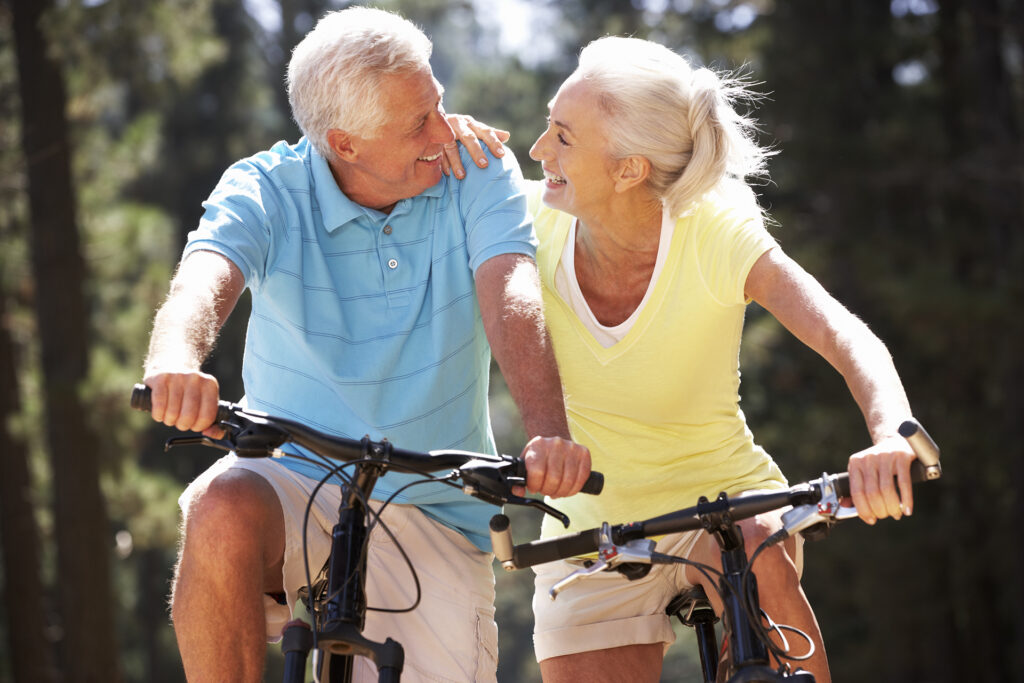Senior couple on country bike ride;
