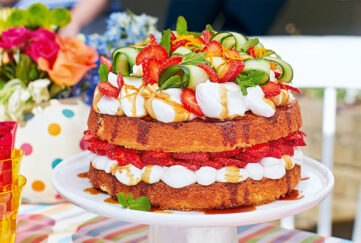 Layered sponge cake with strawberries, cream and cucumber ribbons