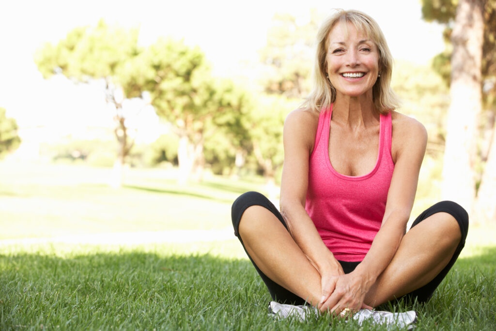 Senior Woman Resting After Exercising In Park;