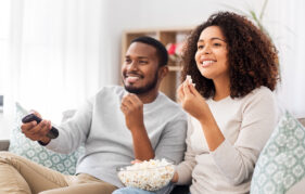 Couple watching movie at home Pic: Shutterstock