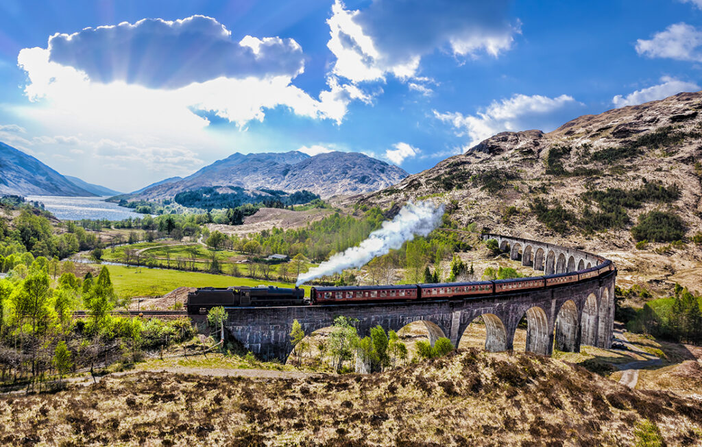 Glenfinnan Railway Viaduct in Scotland with the Jacobite steam train against sunset  Pic: Shutterstock