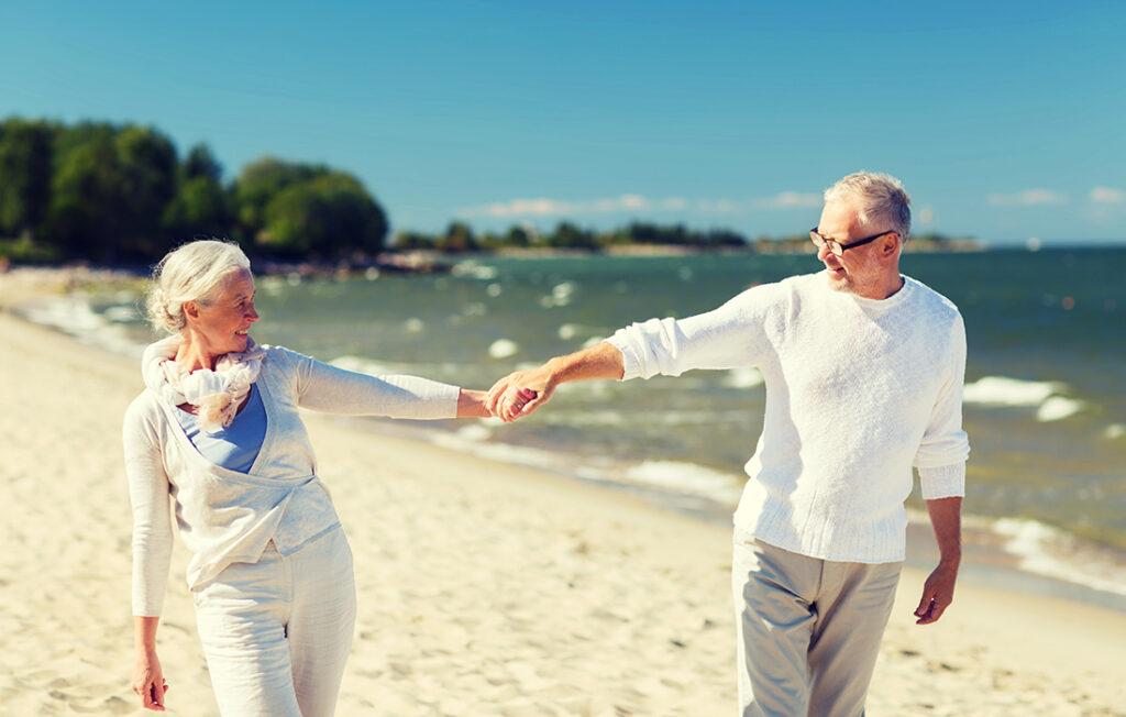 Couple having a romantic walk on beach Pic: Shutterstock
