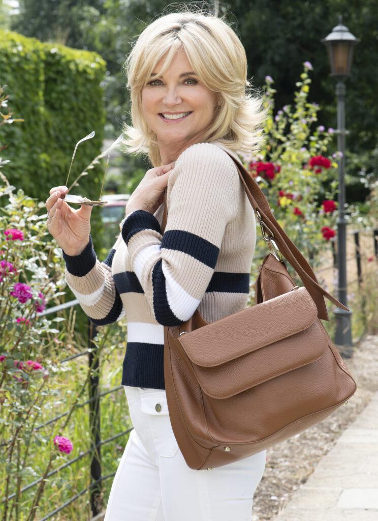Anthea Turner with brown Chrysanthea bag