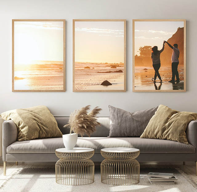 A sofa with 3 pics on wall