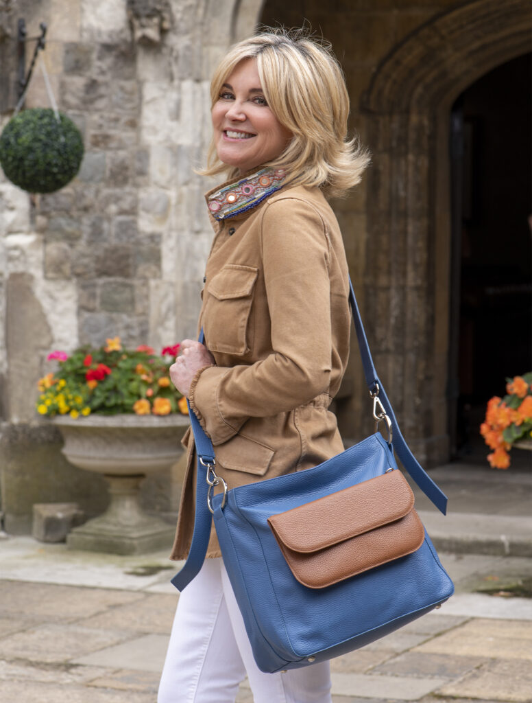 Anthea Turner with blue bag and brown front pocket