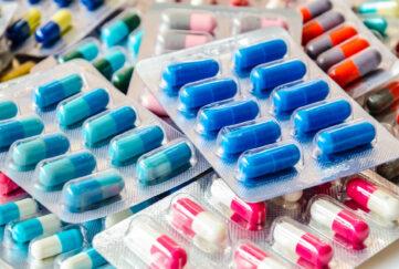 pharmaceuticals antibiotics pills medicine /colorful antibacterials pills on white background /capsule pill medicine ;