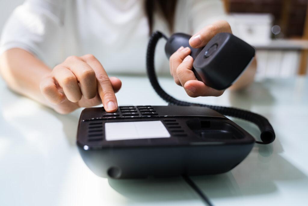 Businesswoman Hand Making Landline Telephone Call Pressing Button;