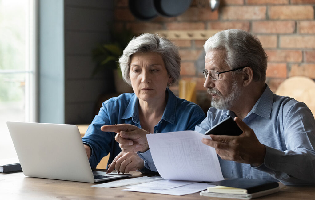 Mature couple working out sums on computer Pic: Shutterstock