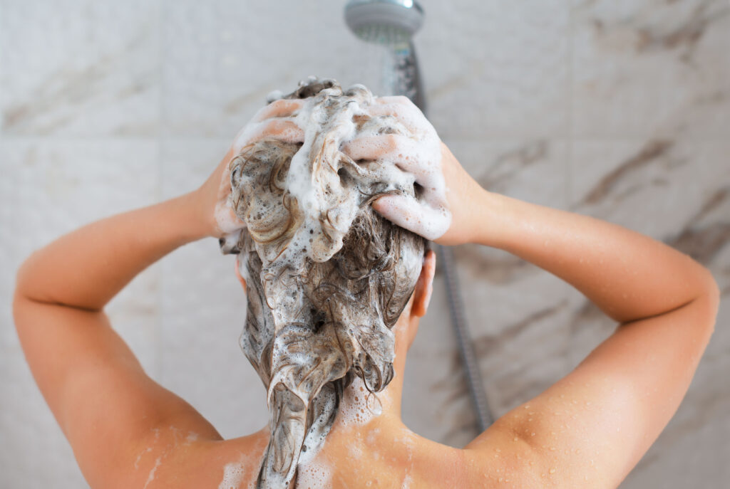 Woman washing her head in the shower