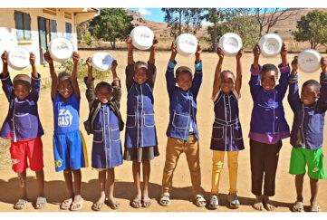 Children celebrating Mary's Meals success in madagascar Pic: Chris Watt