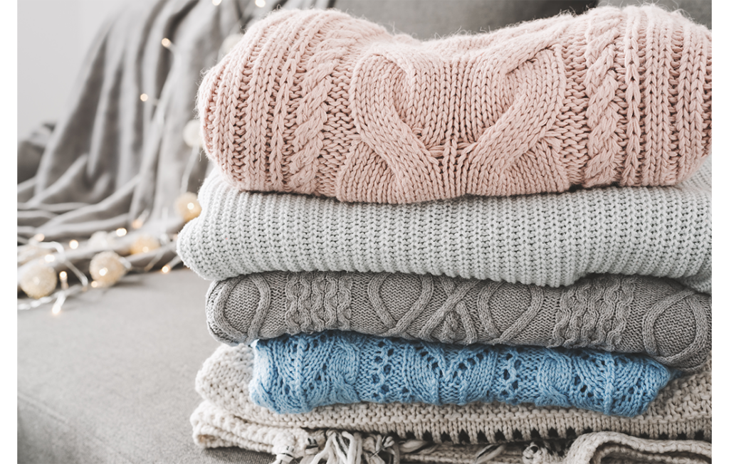Pile of pastel coloured sweaters, folded neatly
