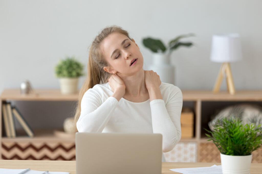 Tired fatigued young woman massaging stiff neck rubbing tensed muscles hurt to relieve back joint shoulder fibromyalgia pain after long sedentary computer work study in incorrect posture concept;