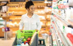 Lady pushing trolley at supermarket Pic: Shutterstock