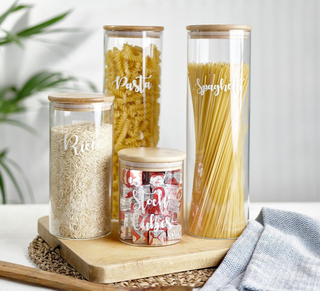 Glass jars with pasta, rice and spaghetti in them