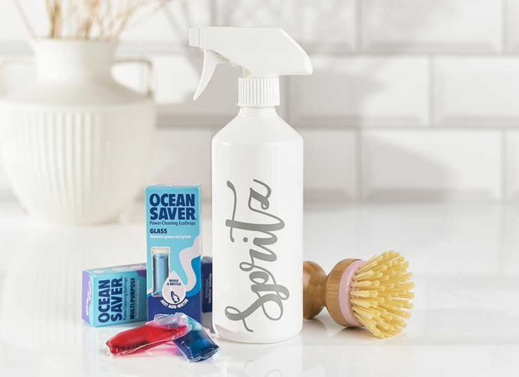 Reuseable spray with scrubbing brush