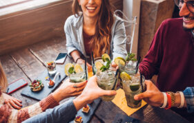 friends drinking mojitos in a bar