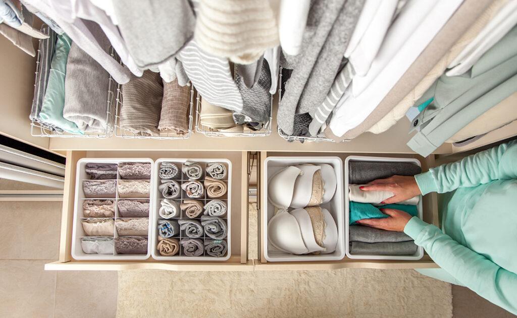 Lady tidying wardrobe Pic: Shutterstock