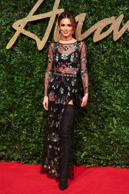 British singer Cheryl Fernandez-Versini poses for pictures on the red carpet upon arrival to attend the British Fashion Awards 2015 in London on November 23, 2015. AFP PHOTO / JACK TAYLOR / AFP / JACK TAYLOR (Photo credit should read JACK TAYLOR/AFP/Getty Images)