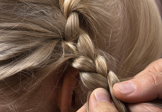 Featured Image for hands of hairdresser weaving braid