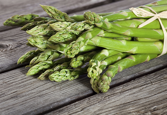 Freshly harvested asparagus on Wooden table.