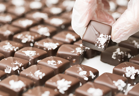 Chocolate making: rows of sea salt caramel truffles. You might also be interested in these: