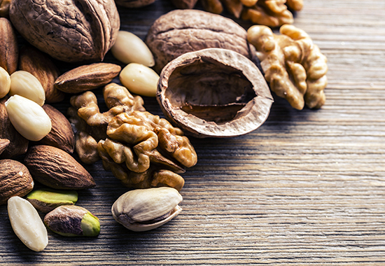 Almonds, walnuts and hazelnuts on wooden table. Various kinds of nuts