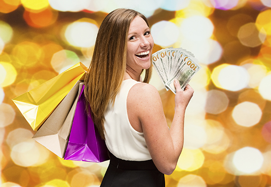 Cheerful woman holding us currencyhttp://www.twodozendesign.info/i/1.png