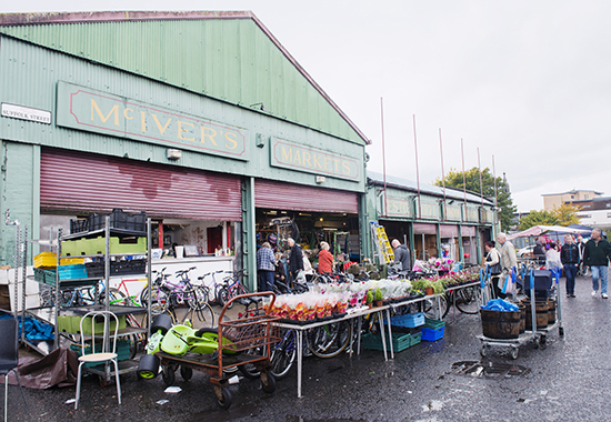 Glasgow, United Kingdom - October 20, 2013: People come to walk around and shop the merchandise set out for sale at the McIver's Market warehouse located in the historic Barras Market Place flea market.